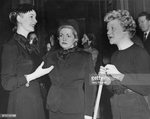 From left to right English actresses Valerie Hobson Hermione Baddeley and Dora Bryan during rehearsals for the show 'Midnight Cavalcade' at the...