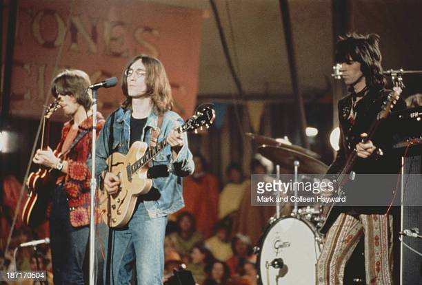 Eric Clapton John Lennon and Keith Richards perform live on stage as The Dirty Mac on the set of the Rolling Stones Rock and Roll Circus at Intertel...