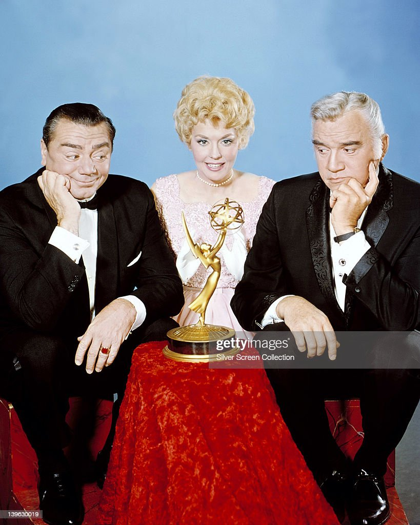 From left to right, Ernest Borgnine, US actor, Donna Douglas, US actress, and Lorne Greene (1915-1987), Canadian actor, pose with an Emmy Award, with Borgnine and Greene looking at the award, in a studio portrait, at the Annual Primetime Emmy Awards, May 1964.