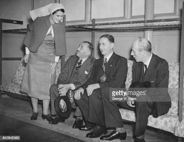 From left to right Ernest Brown the Minister of Health George Overland the Mayor of Poplar and British politician Edward Wood 1st Earl of Halifax try...