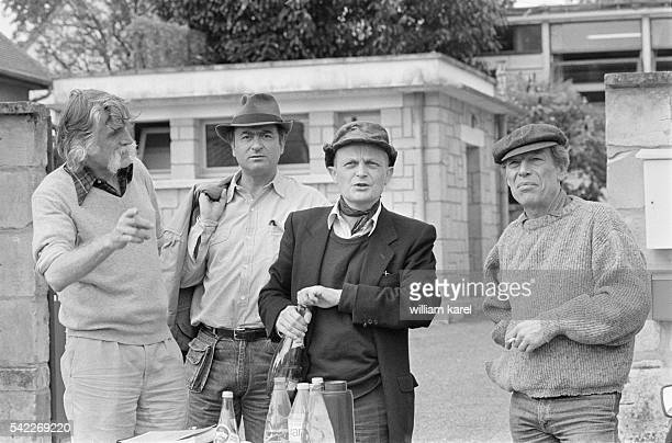 Famous French cartoonists and satirical journalists François Cavanna Georges Wolinski JeanMarc Reiser and Gebe on the set of French film Vive les...