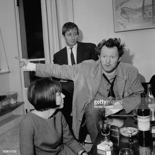 From left to right fashion designer Mary Quant film producer Peter Prowse and actor Richard Harris at a party UK 13th November 1960