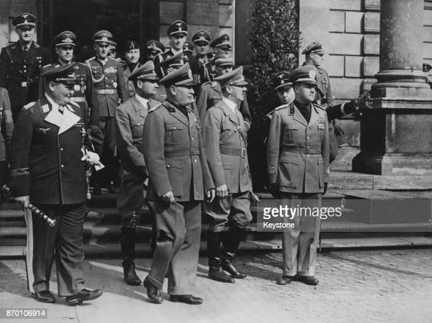 From left to right Field Marshal Hermann Goering Rudolf Hess Italian leader Benito Mussolini German Chancellor Adolf Hitler and Italian Foreign...