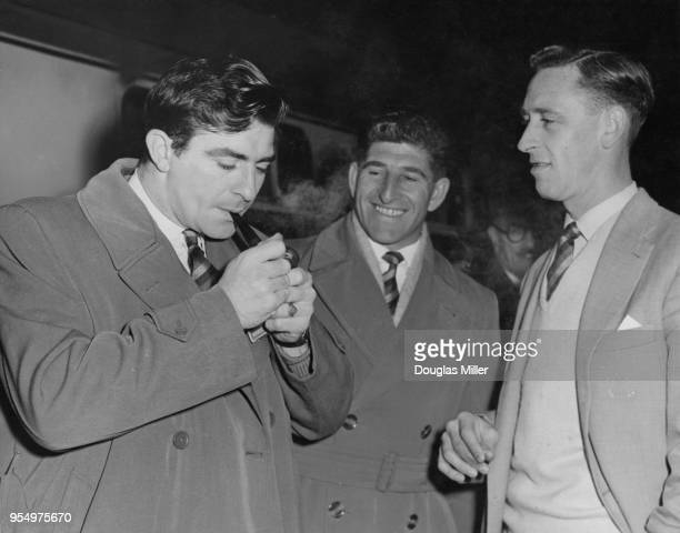 From left to right, Fred Trueman of Yorkshire, Ken Barrington of Surrey and Brian Statham of Lancashire leave Paddington Station with the MCC team,...