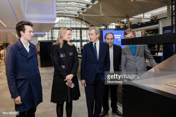 From left to right Frederic Arnault head of connected technologies at Tag Heuer International SA Delphine Arnault executive vice president of LVMH...
