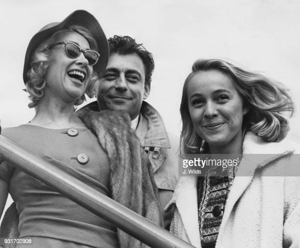 From left to right French actors Martine Carol François Périer and Nicole Berger leave London Airport for Glasgow during the French Film Festival...