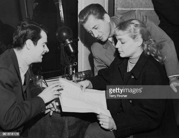 From left to right French actors Serge Reggiani Claude Dauphin and Simone Signoret dub the French film 'Casque d'Or' into English at the RCA Studios...
