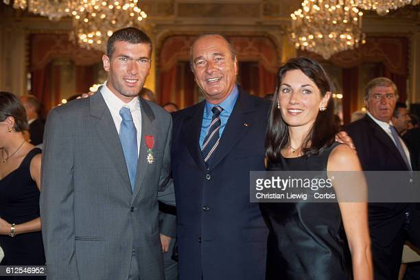 French soccer player Zinedine Zidane French President Jacques Chirac and Zidane's wife Veronique and members of the French soccer team who won the...