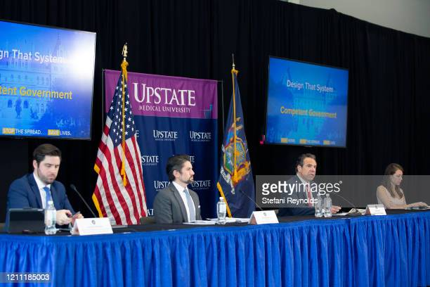 From left to right Gareth Rhodes Deputy Superintendent at the New York State Department of Financial Services Jim Malatras President of SUNY Empire...