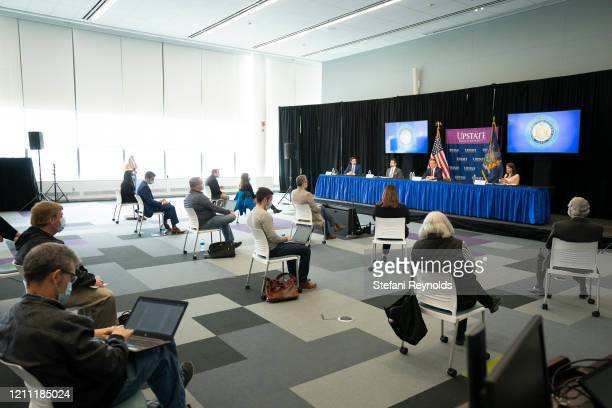 From left to right: Gareth Rhodes, Deputy Superintendent at the New York State Department of Financial Services, Jim Malatras, President of SUNY...