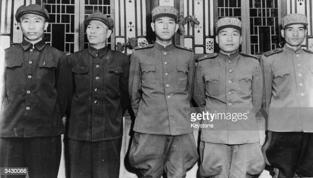 From left to right General Hsieh Fang and Teng Haw of the Chinese Army pose with Nam Il Major General Li Dang Cho and General Chang of the Korean...
