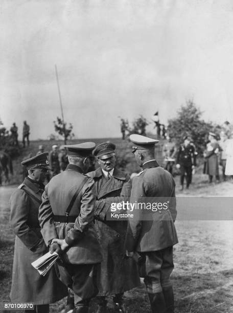 From left to right General von Fritsch Defence Minister and General Werner von Blomberg German Chancellor Adolf Hitler and General Liebmann during...