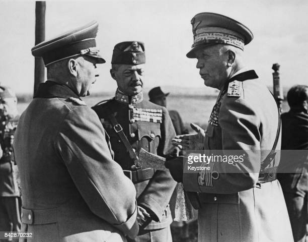 From left to right General Werner von Fritsch CommanderinChief of the German Army with Hungarian War Minister Vilmas Roeder and Marshal Pietro...