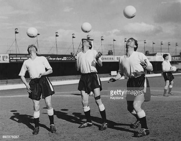 From left to right George Cummins John Groves and Billy Bingham of Luton Town FC training with Wembley balls for the cup final UK 10th April 1959