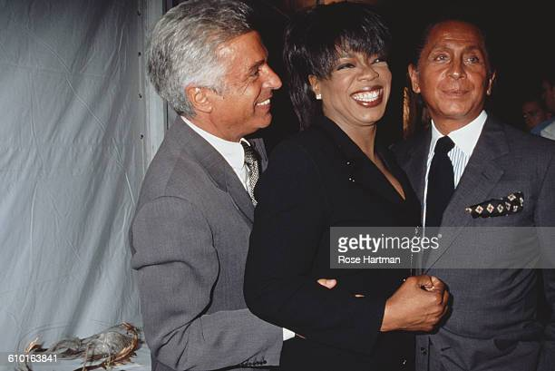 From left to right Giancarlo Giammetti Oprah Winfrey and Valentino at a Valentino fashion show at Bergdorf Goodman New York City 1996