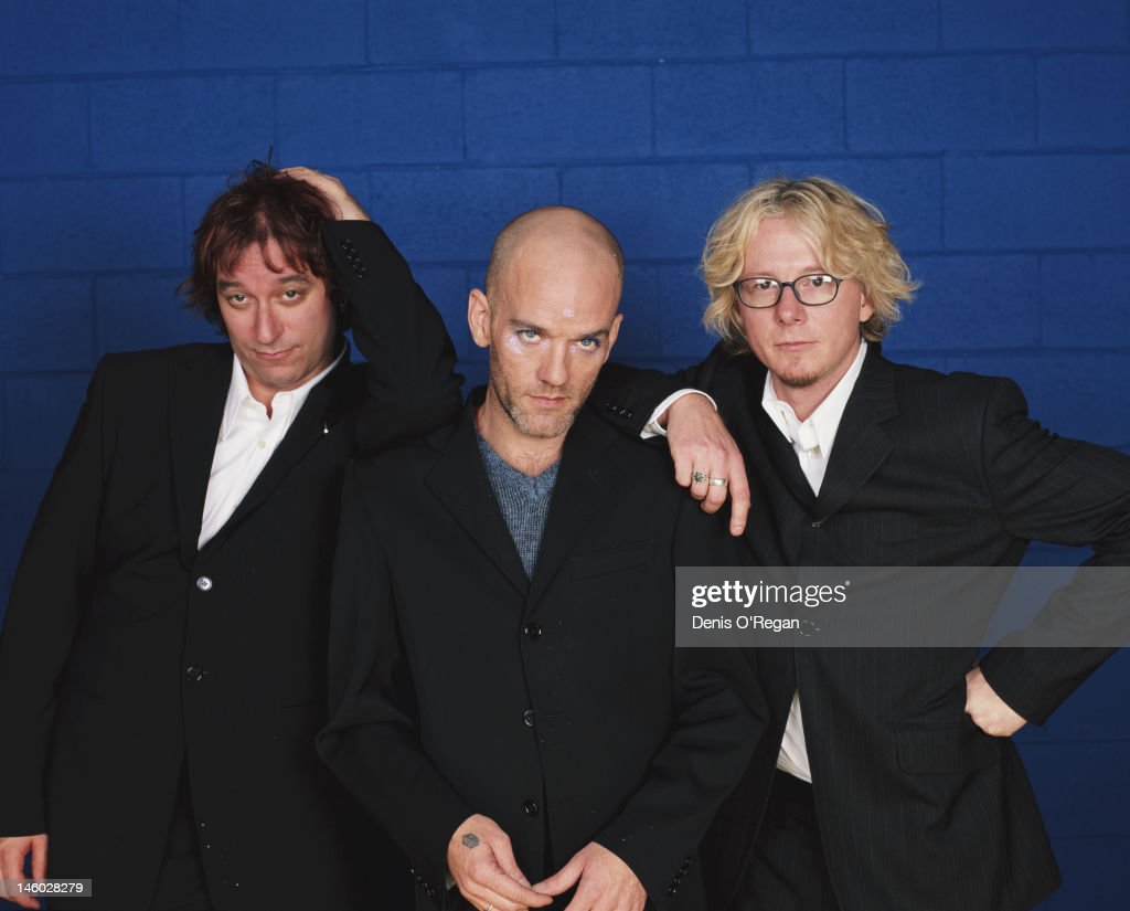 From left to right, guitarist Peter Buck, singer Michael Stipe and bassist Mike Mills of American rock group R.E.M., circa 1990.