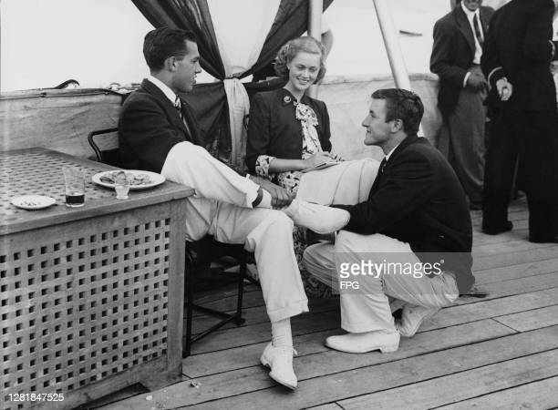 From left to right Henry Duys Jr Miss Nancy Loomis and Richard 'Dick' Jessup from Long Island New York attend an event hosted by the Royal Navy on...