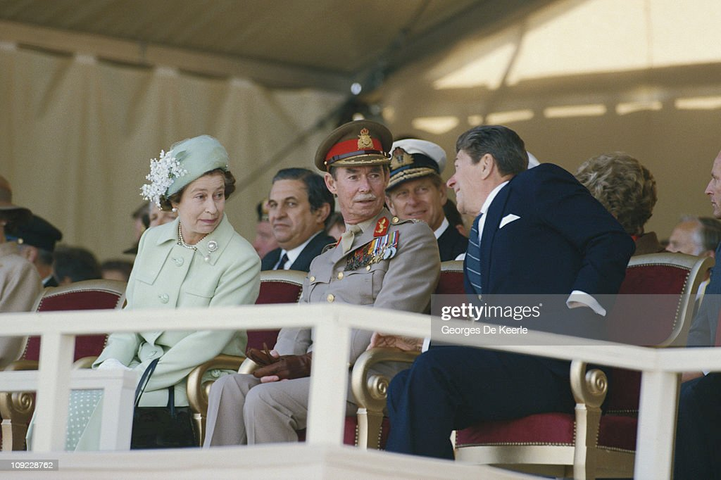 From left to right, Her Majesty Queen Elizabeth II, Grand Duke Jean Of Luxembourg and US President Ronald Reagan commemorate the 40th Anniversary of the D-Day landings at Utah Beach, Normandy, France, 6th June 1984. Prince Philip, the Duke of Edinburgh is seated behind them.