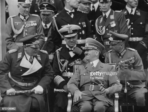 From left to right, Hermann Goering, Grand Admiral Erich Raeder, German Chancellor Adolf Hitler and Field Marshal Walther von Brauchitsch in the...