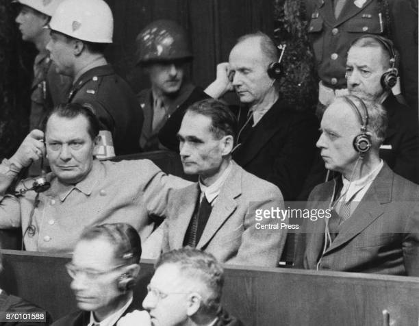 From left to right, Hermann Goering, Rudolf Hess, and Joachim von Ribbentrop face justice at the Nuremberg Trials following World War II, circa 1946.