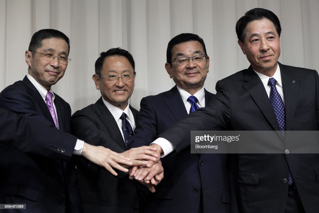 From left to right, Hiroto Saikawa, president and chief executive officer of Nissan Motor Co. and vice chairman of JAMA, Akio Toyoda, president of Toyota Motor Corp. and new chairman of JAMA, Takahiro Hachigo, president and chief executive officer of Honda Motor Co. and vice chairman of JAMA, and Masamichi Kogai, president and chief executive officer of Mazda Motor Corp. and vice chairman of JAMA, pose for photographers during a news conference in Tokyo, Japan, on Thursday, May 17, 2018. Toyoda became the chairman of JAMA today. Photographer: Kiyoshi Ota/Bloomberg via Getty Images