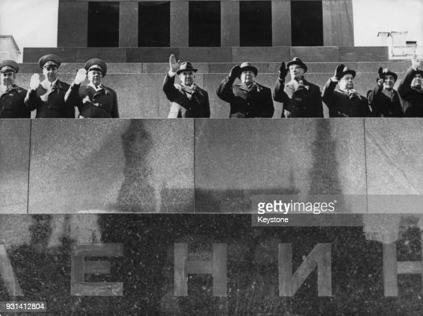 From left to right in centre Soviet leaders Alexei Kosygin Leonid Brezhnev and Mikhail Suslov wave from Lenin's Mausoleum on Red Square in Moscow...