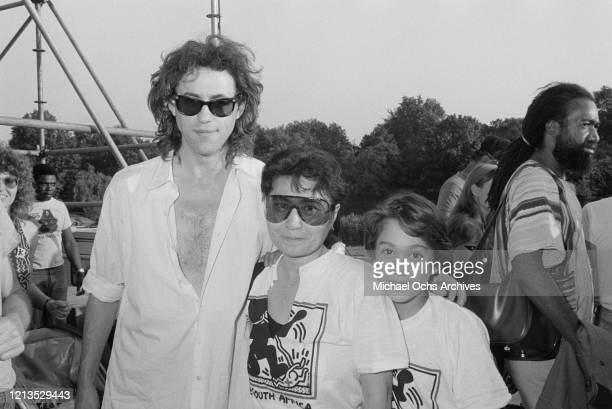 From left to right, Irish singer and songwriter Bob Geldof, Japanese artist Yoko Ono and her son Sean during an Artists United Against Apartheid...