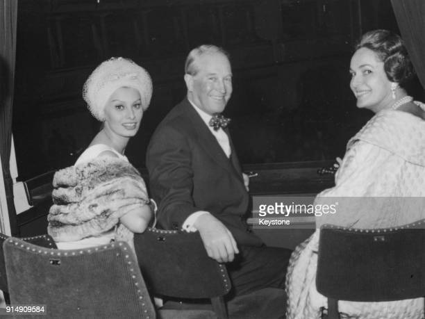 From left to right Italian actress Sophia Loren with French singer Maurice Chevalier and the Begum Om Habibeh Aga Khan at a production of 'Carmen' at...