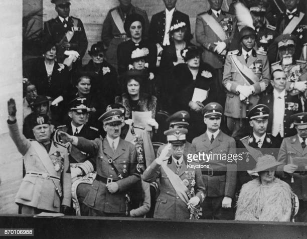 From left to right Italian leader Benito Mussolini German Chancellor Adolf Hitler King Victor Emmanuel III of Italy and Queen Elena of Italy watch a...