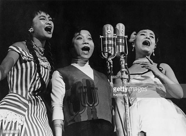 From left to right Izumi Yukimura Chiemi Eri and Hibari Misora three of the top Japanese pop singers of the postwar era perform in a benefit show at...