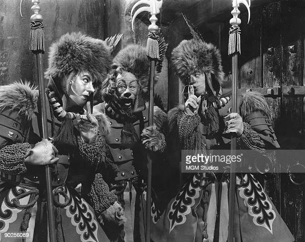 From left to right Jack Haley as the Tin Man Bert Lahr as the Cowardly Lion and Ray Bolger as the Scarecrow in the MGM film 'The Wizard of Oz' 1939...
