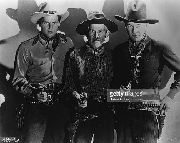 From left to right James Ellison George 'Gabby' Hayes and William Boyd star in another Hopalong Cassidy adventure 'Three On The Trail' directed by...