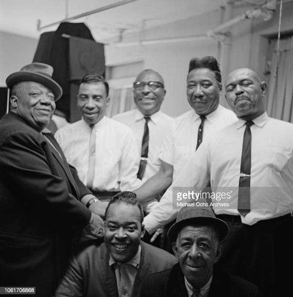 From left to right Jimmy Rushing TBone Walker Sonny Terry Muddy Waters and Brownie McGhee James Cotton and comic MC Spodie Odie backstage at the...