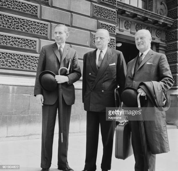 From left to right John Thomson chairman of Barclays Bank Harald Peake of Lloyds Bank and Sir Cuthbert Barwick Clegg of Martins Bank leave the...