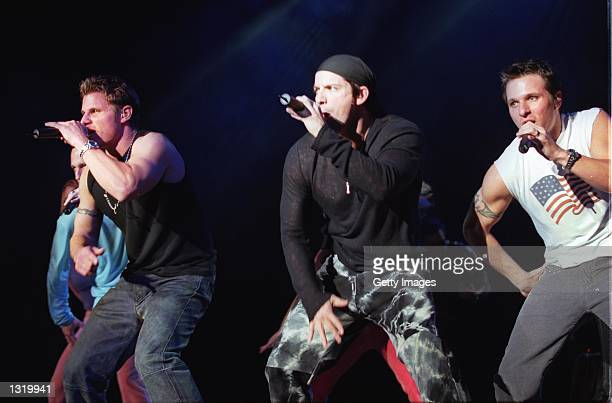 From left to right Justin Lache Nick Lachey Jeff Timmons and Drew Lachey of the boy band 98 Degrees perform at KIISFM''s Holiday Jingle Balls concert...