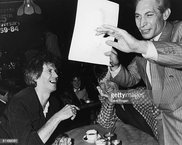 From left to right, Keith Richards, Mick Jagger and Charlie Watts of The Rolling Stones spend a night at Ronnie Scott's in London, 18th November...