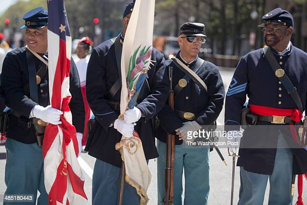 from left to right Kelly Washington Bryan Cheeseboro Anthony Jones and Louise L Carter Jr are Reenactors dressed as the 54th Massachusetts Volunteer...