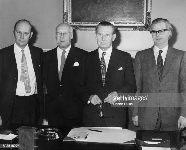 From left to right Labour politician Robert Hughes Baron Hughes of Woodside the Parliamentary UnderSecretary of State for Scotland William Hughes...