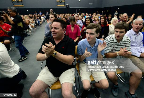 From left to right Lance Kenny and his sons William and James cheer Charlie Kirk and Candace Owens of Turning Point USA as they speak on the...