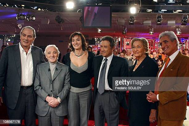 From left to right Laurent Ventura Charles Aznavour Clelia Ventura Michel Drucker Odette Ventura and JeanLoup Dabadie in Paris France on November...