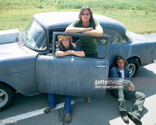 From left to right Laurie Bird as The Girl singersongwriter James Taylor as The Driver and Beach Boys drummer Dennis Wilson as The Mechanic in a...