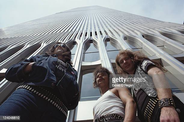 From left to right Lemmy Phil 'Philthy Animal' Taylor and Fast Eddie Clarke of English rock band Motorhead at the foot of the World Trade Centre in...