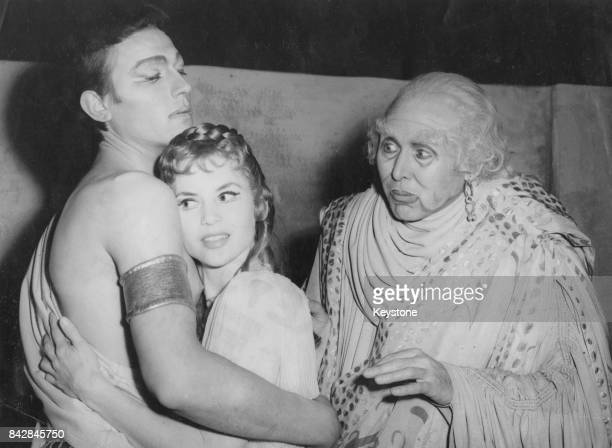 From left to right Lithuanianborn actor Laurence Harvey as Troilus Muriel Pavlow as Cressida and Anthony Quayle as Pandarus in the Shakespeare play...
