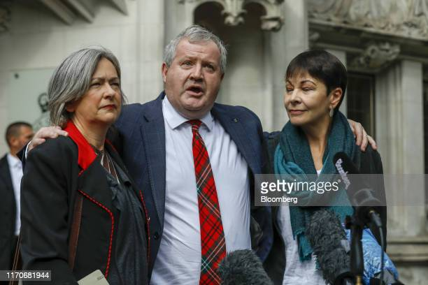 From left to right Liz SavilleRoberts UK lawmaker Ian Blackford UK lawmaker and Caroline Lucas UK lawmaker speak to members of the media outside the...