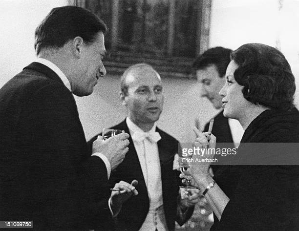 From left to right, Lord Harewood chatting with composers Hans Werner Henze, Richard Rodney Bennett and Australian violinist and fashion model...