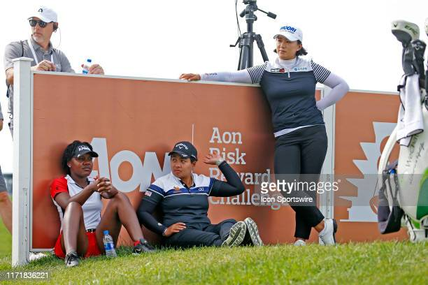 From left to right LPGA golfers Mariah Steakhouse and Pavarisa Yoktuan and Amy Yang wait on the 16th tee during the third round of the Indy Women In...