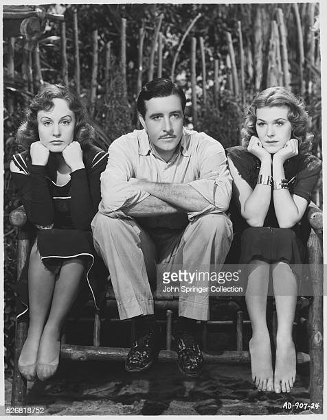 Madge Evans as Anne Wesson John Boles as Jim Taylor and Charlotte Wynters as Thelma Chase in the 1938 movie Sinners in Paradise