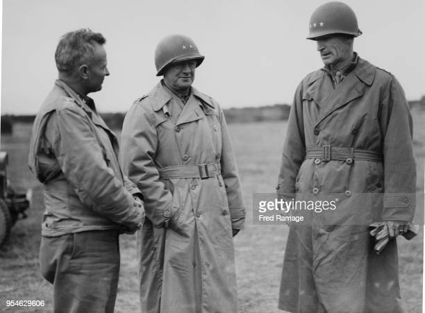 From left to right Major General Donald A Stroh Commander of the US 8th Division Major General Troy H Middleton Commander of the US 8th Army Corps...
