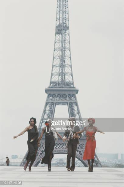 From left to right Marcia Barrett Maizie Williams Bobby Farrell and Liz Mitchell of vocal group Boney M in front of the Eiffel Tower in Paris France...
