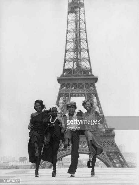 From left to right Marcia Barrett Maizie Williams Bobby Farrell and Liz Mitchell of the German vocal group Boney M in front of the Eiffel Tower in...